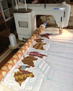 Hens and Coop on New English Quilter Frame